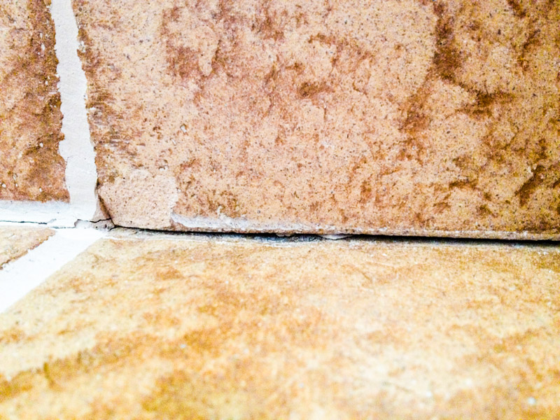 The grout was cracking between the skirting and floor and sometimes breaking the tiles as well