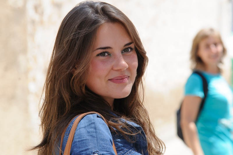 A beautiful Spanish girl at the Useres wine fair, Spain