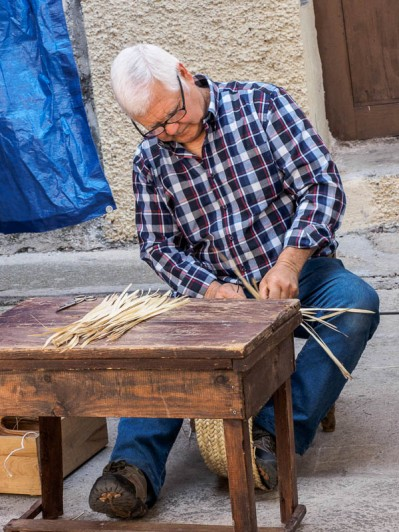 hat weaving at the wine fair, Useres, Spain