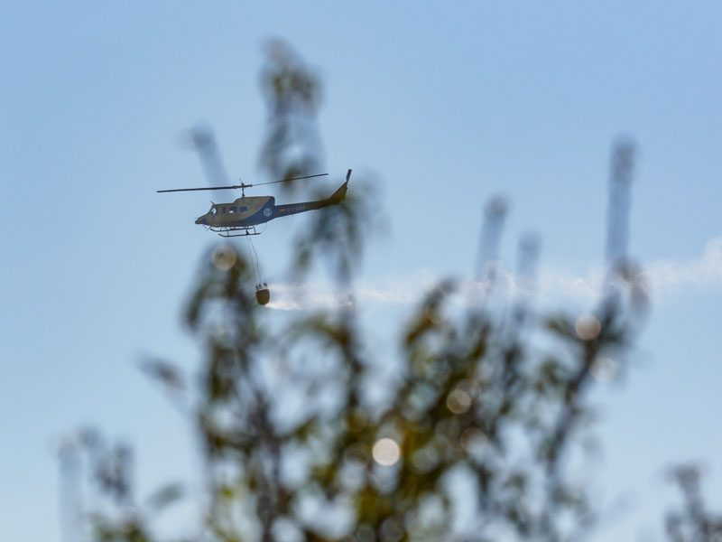 A helicopter carrying water to fight a fire in Spain-4