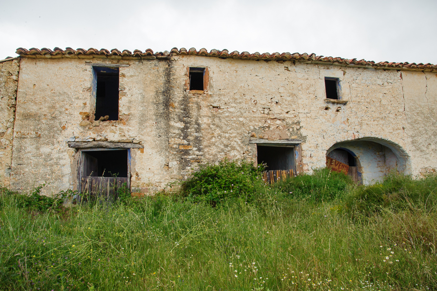 The masia was disappearing under the assault of nature
